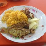 ikan (fish), tomato rice, mutton, and some cucumber and pineapple