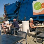 eating next to a garbage truck