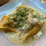 Ricotta cheese ravioli with zucchini flowers and light cheese sauce