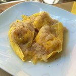 Ricotta cheese ravioli with caramelised pears