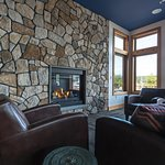 Fireplace and cozy couches in our Event Room