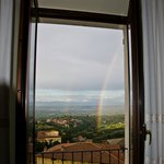 view from the room after a storm with a beautiful rainbow