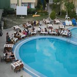 Pool and dining area in the evening