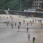 One of many continuous soccer games on the beach.