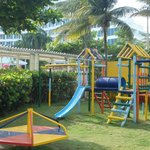 Kids playground behind the pool with water slide
