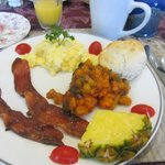Breakfast of maple glazed bacon, sweet potato hashbrowns, eggs, biscuits, oj etc. .  .  .
