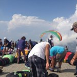 Top of the crowded mountain for paragliding