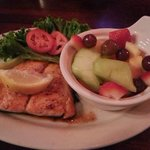 Salmon sandwich without the bun and fresh fruit