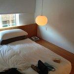 Mattress, wooden floor and hanging lamp