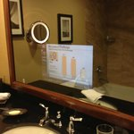 Cool TV inside of bathroom mirror
