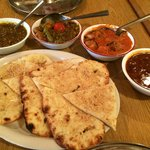 Four Entrees with Garlic Naan