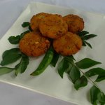 Savoury lentil snacks spiked with curry leaves.