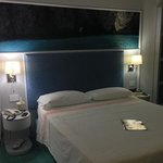 our bed with beautiful painting of the blue grotto