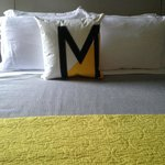 Sailcloth Accent Pillow on bed.