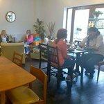 Customers relaxing and enjoying a Ploughmans platter