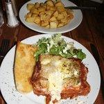 Lasagna, garlic bread, side salad, Garlic potatoes.