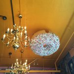Doughnut on the ceiling next to the chandelier.