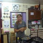 Khun Poo explaining cooking technique