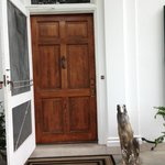 the lovely heavy wood door to enter the front of the house