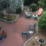 The Secret Garden's serene garden, with gazebo and fountain, seen from the deck.