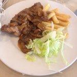 Steak, mushroom sauce, chips and lettuce