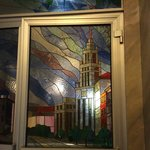 Stained glass door, 2nd floor on way into dining room, showing one of Stalin's Seven Sisters