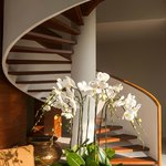 Spiral staircase connects dining and living areas