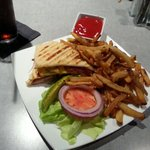 Turkey club panini with fries.