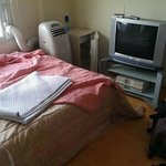 Our room included TV, A/C, a fridge and a double bed.