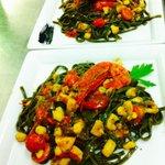 Fettuccine nere con seppie, gamberone rosso siciliano e pomodorini saltati