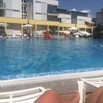 Huge pool!! With kids slides cordoned off.