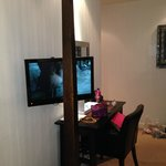 Tiny TV obscured by the upgraded 4 poster bed we paid extra for and no DVD