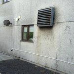 Dirty, grotty walls and noisy air condition unit