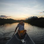 Hugo (a local guide) paddling for an Amazon sunset.