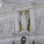 Statue of the goddess Roma on a gold background