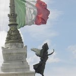 """National flag over the statue  of """"CIVIUM LIBERTATI"""""""