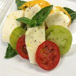 House Made Mozzarella and Heirloom Tomato, Fresh Basil , EVOO