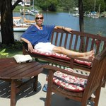 Relaxing by the pool, bay cove in background.