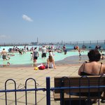 Free paddling pool area has seating around the edge for adults