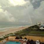 Beautiful picture of a rainbow on the beach. Picture was taken from our hotel room door.