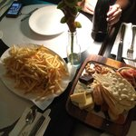 Large serving of truffle fries at SGD 15++, basic cheese platter selection at SGD 29++