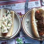 "One dog ""up"" (chili, mustard, onions) one with slaw!"