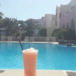 Pool view with a Strawberry daquiri