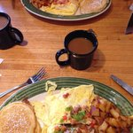 Mexican style omelette (bottom), ham and cheese style omelette (top), served with apple fries an