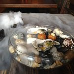 Oyster and fish cake on dry ice