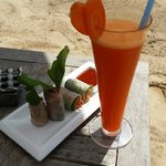 Beef rice paper rolls and a fresh carrot juice by the poolside. Healthy and yum :)