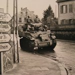 Display photo: note the German spelling on the signposts (The Germans did this all across France