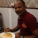 My friend @ tastebudz enjoying the dosa and parrata ( kerala special)