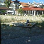 Детская площадка. Вид на отель и место, где завтракали и ужинали