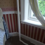 Galvanised iron pipe next to bed
